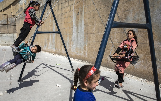 Children play inside a sports stadium that is being used as an emergency shelter for displaced families, in Idlib, Syria on March 4, 2020. The New York Times