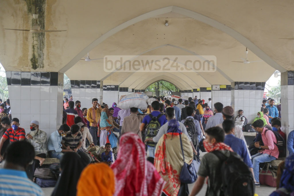 Panicked people overcrowd Kamalapur Railway Station on Tuesday to leave Dhaka after the government announced a 10-day holiday and shut down public transport urging the people to stay at home to stem the spread of the coronavirus. Photo: Mahmud Zaman Ovi