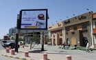 People walk near a banner with an instruction on personnel hygiene, following the outbreak of coronavirus, at a street in Riyadh, Saudi Arabia, March 16, 2020. The banner reads: