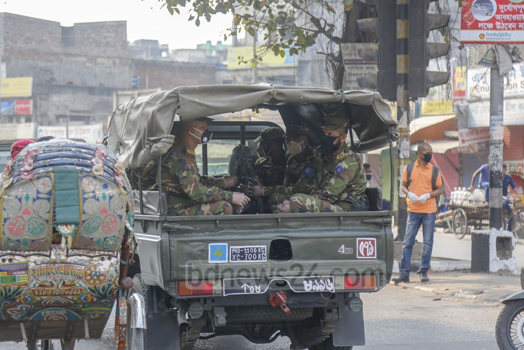 A group of army personnel patrolling Dhaka's Tantibazar neighbourhood on Wednesday to assist the civil administration in the coronavirus fight • Photo: Mahmud Zaman Ovi