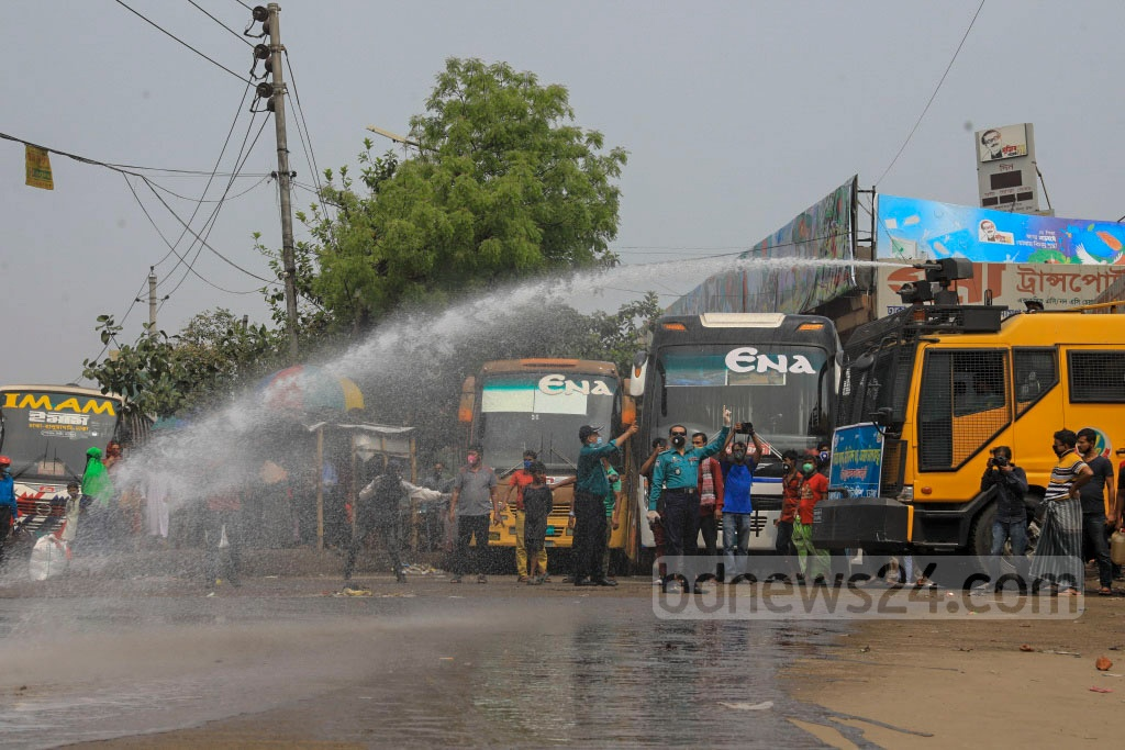 Dhaka Metropolitan Police spraying disinfectants through water cannons at the capital's Mohakhali Bus Terminal on Wednesday to stem the spread of coronavirus. Photo: Asif Mahmud Ove