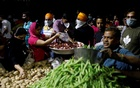People buy vegetables at a market after India's Prime Minister Narendra Modi called for a nationwide lockdown starting midnight to limit the spreading of coronavirus disease (COVID-19), in New Delhi, India, Mar 24, 2020. REUTERS