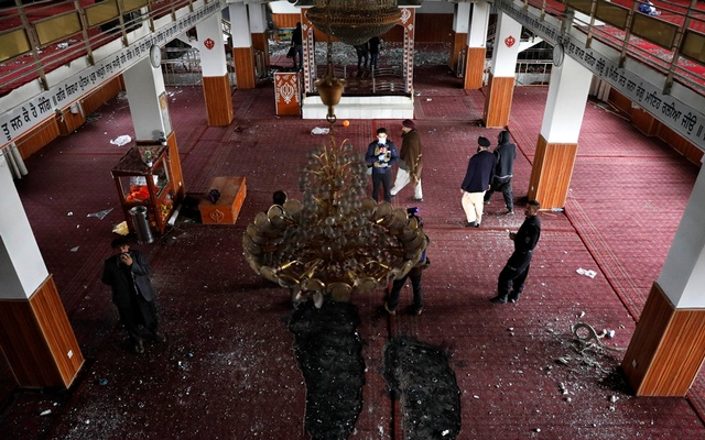 Men walk inside the Sikh religious complex after an attack in Kabul, Afghanistan March 25, 2020. REUTERS