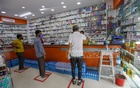 A pharmacy in Dhaka's Gulshan has drawn boxes to ensure social distancing of customers amid a coronavirus outbreak. Photo: Mahmud Zaman Ovi