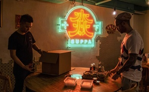 From left, Bong Kwok and Jason Ho prepare a takeout order at Suppa, their hot pot restaurant in Hong Kong, in March 9, 2020. The New York Times