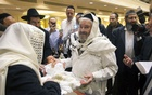 Romi Cohn, born Avraham Hakohen Cohn, performs a circumcision at Congregation Ahaba Ve Ahva in Brooklyn, in 2014. The New York Times