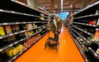 A shopper walks through an aisle empty of pasta, rice, beans and soup at a Loblaws supermarket in Toronto, Ontario, Canada, March 14, 2020. REUTERS