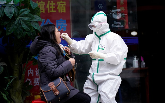 Reuters reporter Brenda Goh receives a nucleic acid test for COVID-19 in Wuhan, Hubei province, the epicenter of China's coronavirus disease (COVID-19) outbreak, March 28, 2020. REUTERS