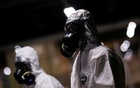 Members of the armed forces wearing protective suits are seen before disinfecting the Metro's Central station, amid coronavirus disease (COVID-19) outbreak, in Brasilia, Brazil, Mar 29, 2020. REUTERS