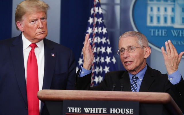 US President Donald Trump listens as Dr. Anthony Fauci, Director of the National Institute of Allergy and Infectious Diseases, addresses the coronavirus task force daily briefing at the White House in Washington, US, March 24, 2020. Reuters