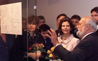 Famous Polish composer Krzysztof Penderecki explains to Queen of Sweden Silvia his draft of a score during their visit to the Penderecki exhibition in Krakow, Poland Sept 18, 1998. REUTERS