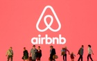 Small toy figures are seen in front of displayed Airbnb logo in this illustration taken March 19, 2020. REUTERS