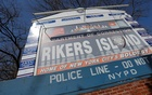 Signage is seen outside of Rikers Island, a prison facility, where multiple cases of the coronavirus disease (COVID-19) have been confirmed in Queens, New York City, US, March 22, 2020. REUTERS