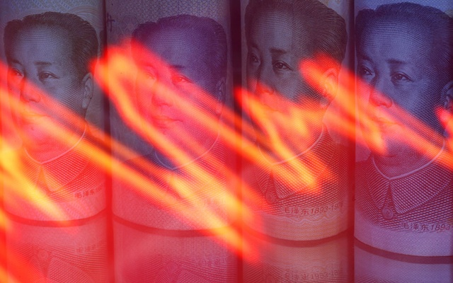 Chinese Yuan banknotes are seen behind illuminated stock graph in this illustration taken February 10, 2020. REUTERS