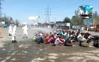 Outrage in India as migrants sprayed with disinfectant to fight coronavirus