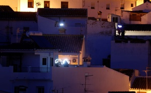 People turn on flashlights from their homes in support for healthcare workers during the coronavirus disease (COVID-19) outbreak, in Ronda, southern Spain March 28, 2020. REUTERS