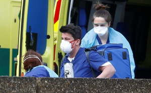 Medical staff wearing protective masks and clothing in a Ambulance outside St Thomas' hospital, as the spread of the coronavirus disease (COVID-19) continues, London, Britain, Mar 29, 2020. REUTERS