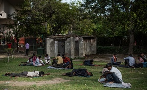 Migrant workers rest at a park in New Delhi, March 25, 2020. Millions of migrant labourers in Indian cities live and eat where they work, and the sudden shutdown of businesses has upended their lives. (Rebecca Conway/The New York Times)