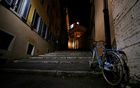 A bicycle is seen on one of the steps leading up to the Quirinale Presidential Palace is lit up with the colours of the Italian flag as Italy continues to battle the coronavirus disease (COVID-19), in Rome, Italy, March 30, 2020. REUTERS