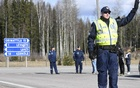 Finnish police officers are seen at the checkpoint in Mantsala, at the northern border of the Uusimaa (Nyland) region, in Finland, Mar 28, 2020. REUTERS