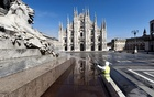 A worker wearing protective garments sanitises the Duomo square, during the coronavirus disease (COVID-19) outbreak in central Milan, Italy March 31, 2020. Reuters