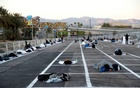 Homeless people sleep in a temporary parking lot shelter at Cashman Center, with spaces marked for social distancing to help slow the spread of coronavirus disease (COVID-19) in Las Vegas, Nevada, US March 30, 2020. Reuters