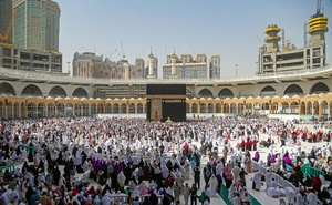 FILE PHOTO: Muslim pilgrims wear protective face masks, following the outbreak of the coronavirus, as they pray at Kaaba in the Grand mosque in the holy city of Mecca, Saudi Arabia March 3, 2020. REUTERS