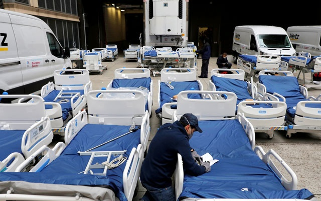 A worker checks part of a delivery of 64 hospital beds from Hillrom to The Mount Sinai Hospital during the outbreak of the coronavirus disease (COVID-19) in Manhattan, New York City, US, March 31, 2020. Reuters