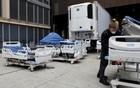 A worker inspects part of a delivery of 64 hospital beds from Hillrom to The Mount Sinai Hospital during the outbreak of the coronavirus disease (COVID-19) in Manhattan, New York City, US, March 31, 2020. REUTERS