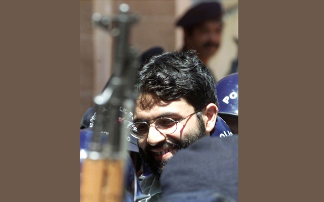 British-born Islamic militant Ahmed Omar Saeed Sheikh is surrounded by armed police as he arrives at a court in Karachi, Pakistan Mar 29, 2002. REUTERS