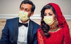 Doctors Kashif Chaudhry and Naila Shereen wear face masks after their wedding in New Windsor, New York, US, Mar 21, 2020 amid an outbreak of coronavirus disease (COVID-19). REUTERS