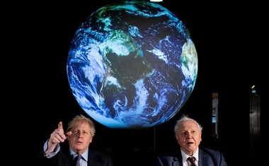 British Prime Minister Boris Johnson and David Attenborough speak with school children during a conference about the UK-hosted COP26 UN Climate Summit, at the Science Museum in London, Britain February 4, 2020. REUTERS