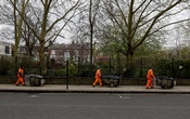 Street cleaners observe social distancing guidelines on a street in Chelsea as the spread of the coronavirus disease (COVID-19) continues in London, Britain, April 2, 2020. REUTERS