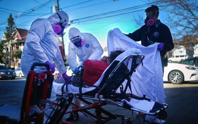 Fire Department emergency medical technicians in Paterson, NJ, attend to a patient under investigation of having the coronavirus during a morning shift on Tuesday, Mar 24, 2020. The New York Times