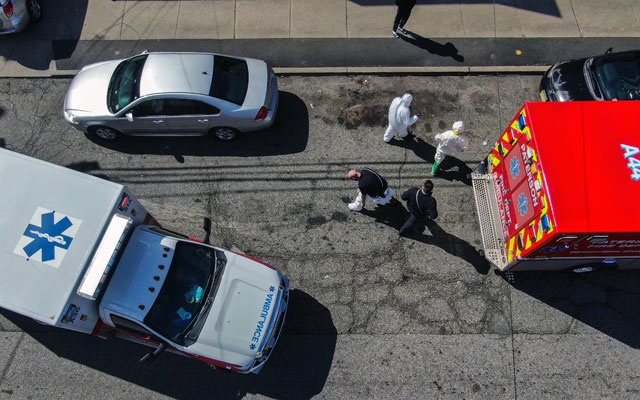 Fire Department emergency medical technicians in Paterson, NJ, on a call for two suspected cases of coronavirus on Tuesday, Mar 24, 2020. The New York Times