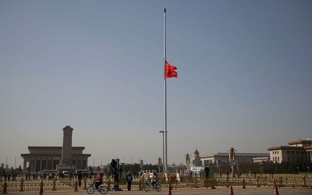 The Chinese national flag flies at half-mast at Tiananmen Square in Beijing, as China holds a national mourning for those who died of the coronavirus disease (COVID-19), on the Qingming tomb sweeping festival, April 4, 2020. REUTERS