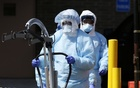 Workers in personal protective equipment (PPE) push equipment for moving patients outside Wyckoff Heights Medical Centre in Brooklyn during the outbreak of the coronavirus disease (COVID-19) in New York City, New York, US, Apr 1, 2020. REUTERS