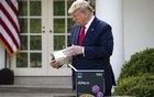 President Donald Trump inspects a test kit for the coronavirus known as COVID-19, developed by Abbott Laboratories, during a news conference with the coronavirus task force at the White House in Washington, Monday, March 30, 2020. (Al Drago/The New York Times)
