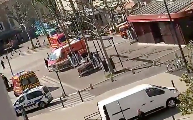 Emergency services arrive on a scene of a knife attack in Romans-sur-Isere near Lyon, France April 4, 2020 in this screen grab obtained from a social media video. Twitter/@imyurika_ /via REUTERS
