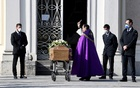 A priest blesses the coffin of a woman who died from coronavirus disease (COVID-19) at her funeral, as Italy struggles to contain the spread of coronavirus disease (COVID-19), in Seriate, Italy March 28, 2020. REUTERS