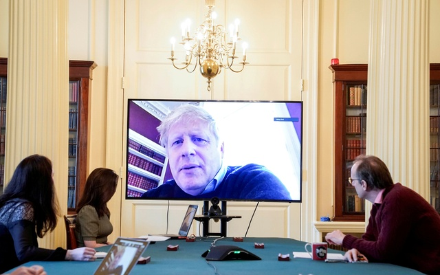 Britain's Prime Minister Boris Johnson appears on a monitor for the coronavirus disease (COVID-19) meeting in London, Britain March 28, 2020. The prime minister chairs the morning update meeting on the coronavirus remotely from Number 11 Downing Street, since self-isolating after testing positive for the virus. Andrew Parsons/10 Downing Street/Handout via REUTERS