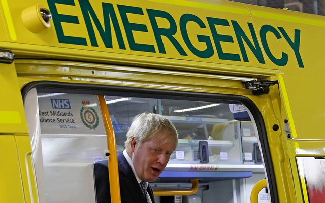 FILE PHOTO: Britain's Prime Minister Boris Johnson looks out from an ambulance during a visit to Pilgrim Hospital in Boston, Britain August 5, 2019. Darren Staples/Pool via Reuters