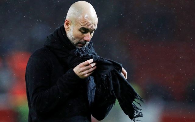 Manchester City manager Pep Guardiola looks dejected after the match. Soccer Football - Premier League - Manchester United v Manchester City - Old Trafford, Manchester, Britain - March 8, 2020. Reuters