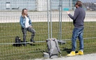 German Maja Bulic and her Swiss friend Jean-Pierre Walter (R) talk through two fences set up by Swiss and German authorities on the German-Swiss border as a protection measure due to the spread of the coronavirus disease (COVID-19) in Kreuzlingen, Switzerland April 5, 2020. Reuters