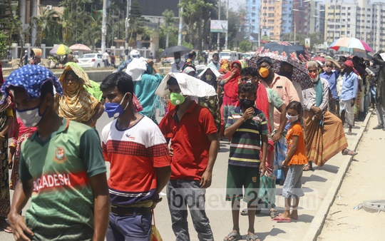 People gather to buy subsidised rice at Tk 10 per kg in Dhaka on Sunday, defying instructions to maintain a safe distance from each other to check coronavirus infection. Photo: Asif Mahmud Ove