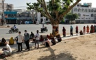 People wait in queues alongside a road to enter a bank during a 21-day nationwide lockdown to slow the spreading of coronavirus disease (COVID-19) in Agra, India, Apr 7, 2020. REUTERS