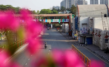 A commuter rides on a bike on an empty street during countrywide lockdown due to coronavirus disease (COVID-19) outbreak in Dhaka, Bangladesh, Mar 28, 2020. REUTERS