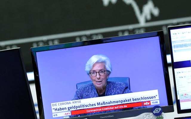 A television broadcast showing Christine Lagarde, President of the European Central Bank (ECB), is pictured during a trading session at Frankfurt's stock exchange in Frankfurt, Germany, Mar 12, 2020. REUTERS