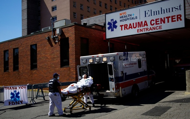 Paramedics wheel a patient from an ambulance to an emergency arrival area at Elmhurst Hospital during the outbreak of the coronavirus disease (COVID-19) in the Queens borough of New York City, New York, US, April 6, 2020. Reuters