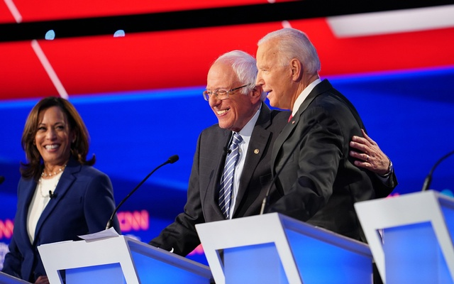 FILE - Sen. Bernie Sanders (I-Vt.), centre, and former Vice President Joe Biden during the Democratic presidential debate in Westerville, Ohio, Oct. 15, 2019. Looking on at left is fellow presidential candidate Sen. Kamala Harris. Sanders withdrew from the race April 8, 2020. (Tamir Kalifa/The New York Times)